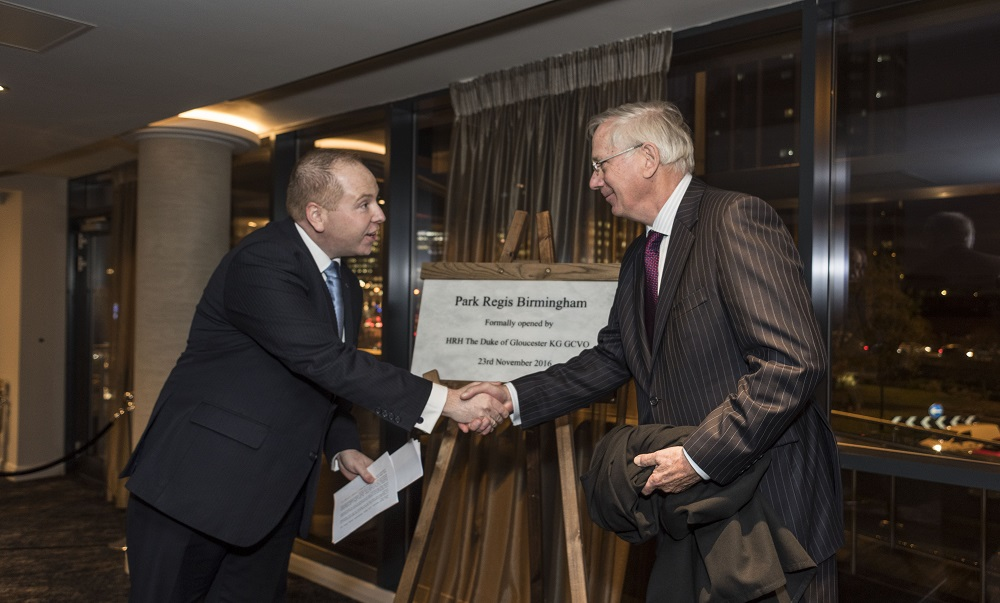 The Duke of Gloucester, Prince Richard unveils a plaque to commemorate the official opening of Park Regis Birmingham alongside general manager Robin Ford.