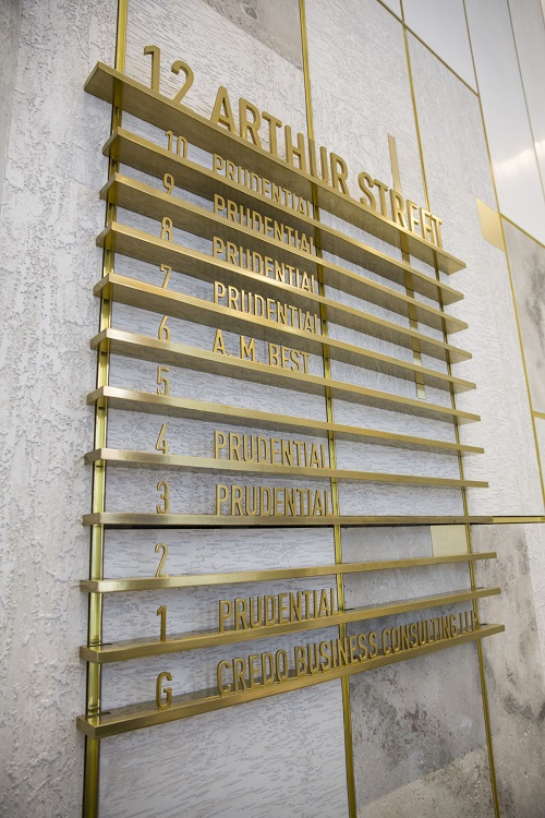 Signbox delivers stunning brass-effect directory for prestigious London office building 12 Arthur Street