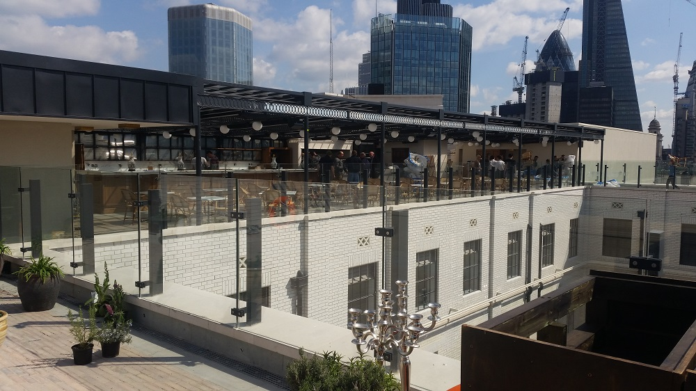Hard work pays off for tricon at the ned hotel designs for Rooftop bar and terrace