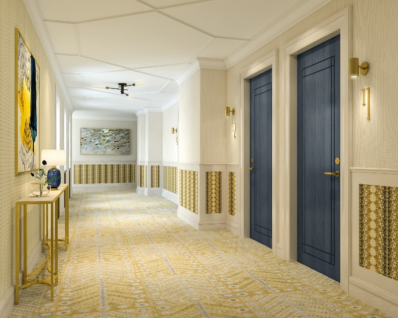 Large corridor with subtle accents of gold in the wallcoverings and carpet mixed with deep blue doors