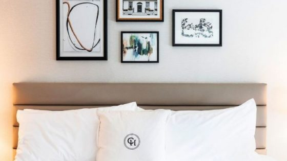 Close-up of bed with striking modern art above bed