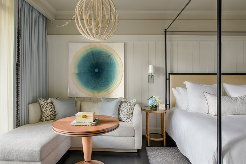 Soft white interiors compliment accents of ocean blue art