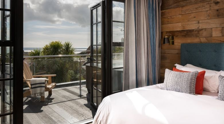 Modern guestroom with views over Falmouth Bay