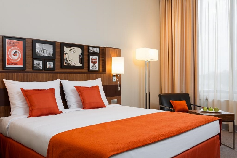 Guestroom with orange accents