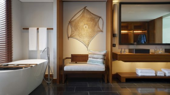 Modern, sleek bathroom with focus on wood