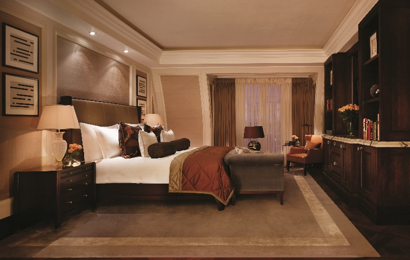 The Writer's Penthouse bedroom at Corinthia London, adorned in dark hues
