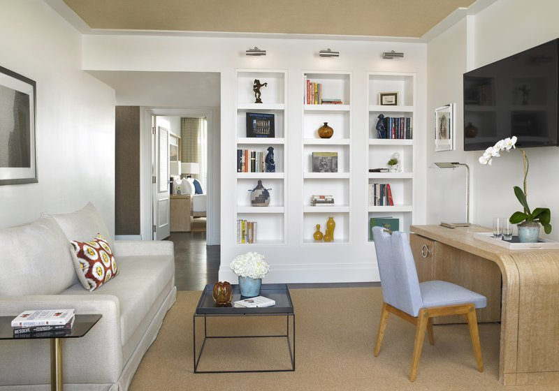 Light, bright and fresh interiors. Cream sofa and statement bookcase