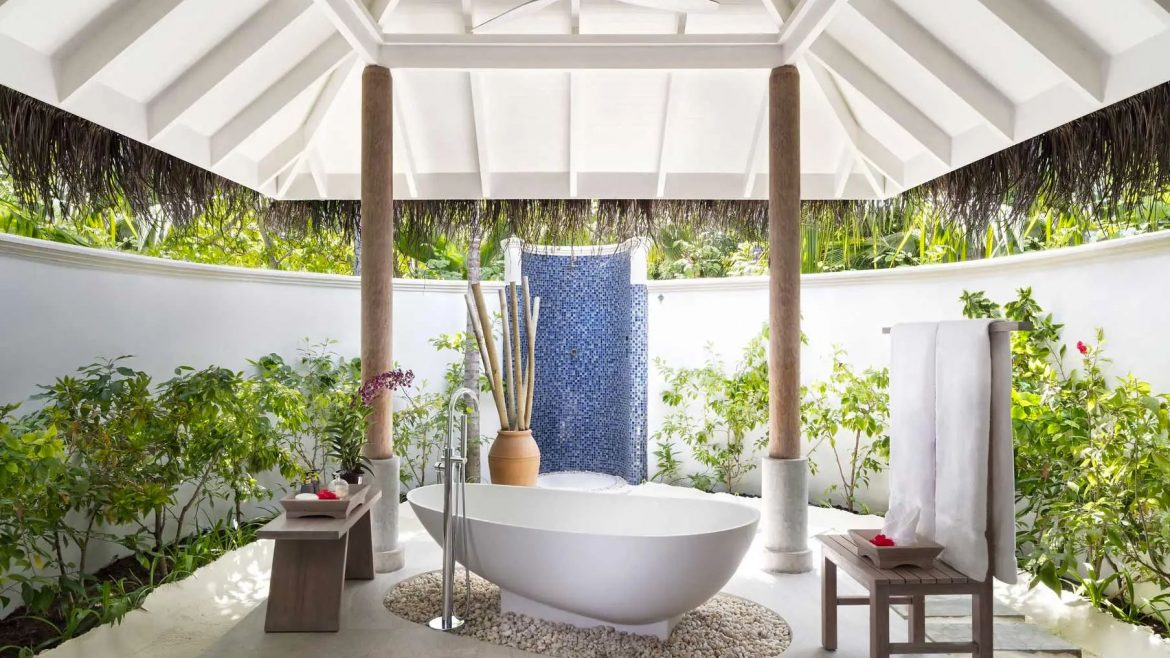Luxury outside bathroom with plants around the the outside