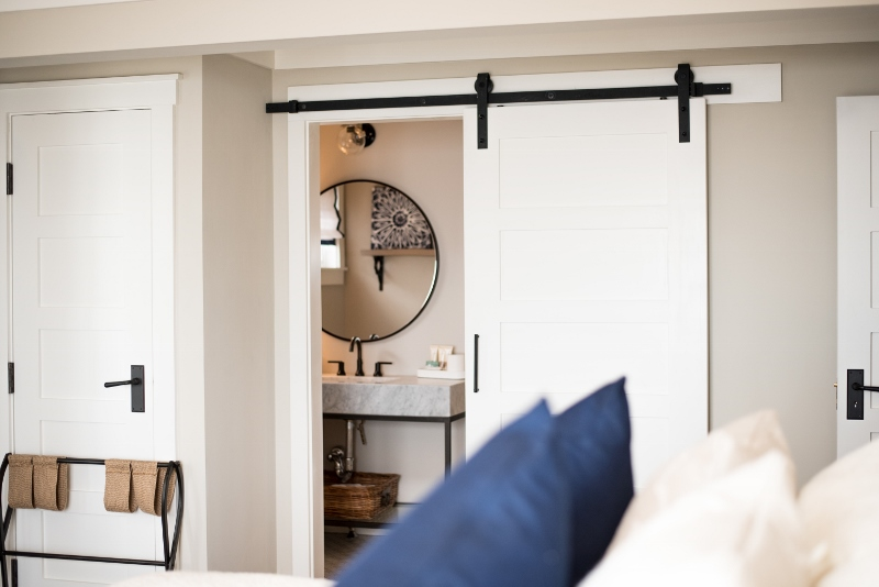 Large sliding door dividing the guestroom from the bathroom