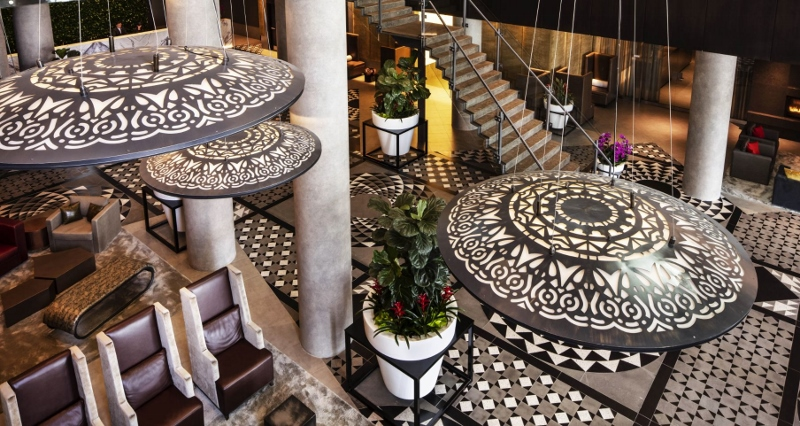 Black and white tiles echo in the balck and white chandeliers in the lobby