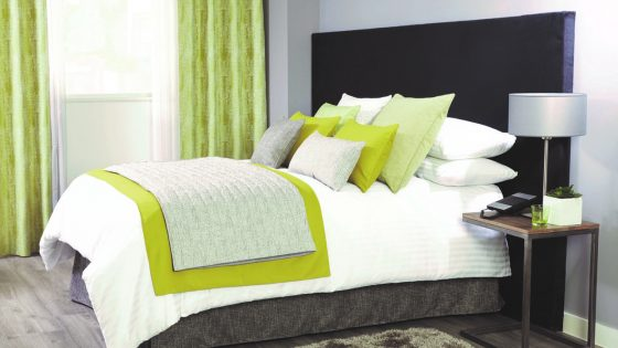 Bed with green cushions