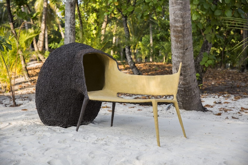 A contemporary bench on a white beach