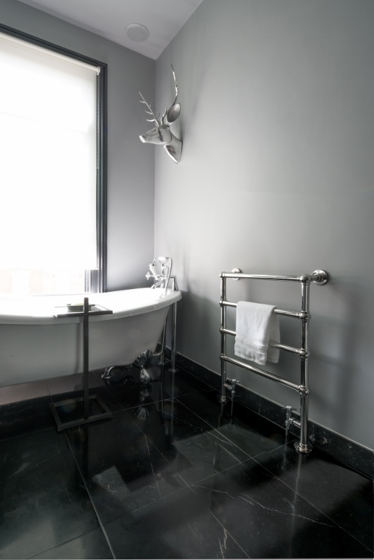 Traditional radiator in modern bathroom