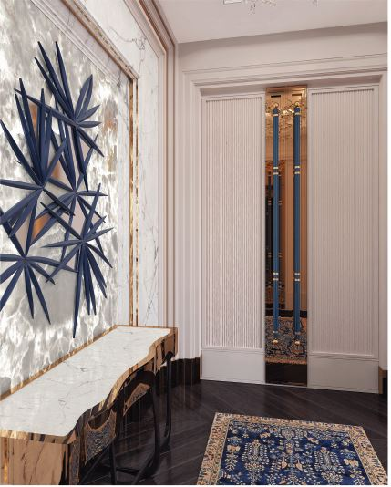 Entrance of the Ritz Carlton Suite with blue art piece on the wall and blue and gold rug
