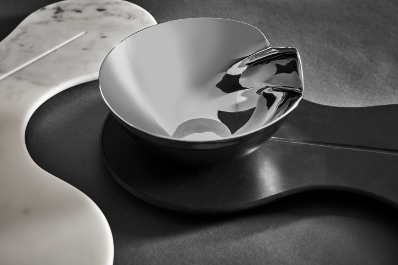 CELL range include the Platter in Nero Marquina or Statuario marble, and the Plate & Bowl Set in porcelain