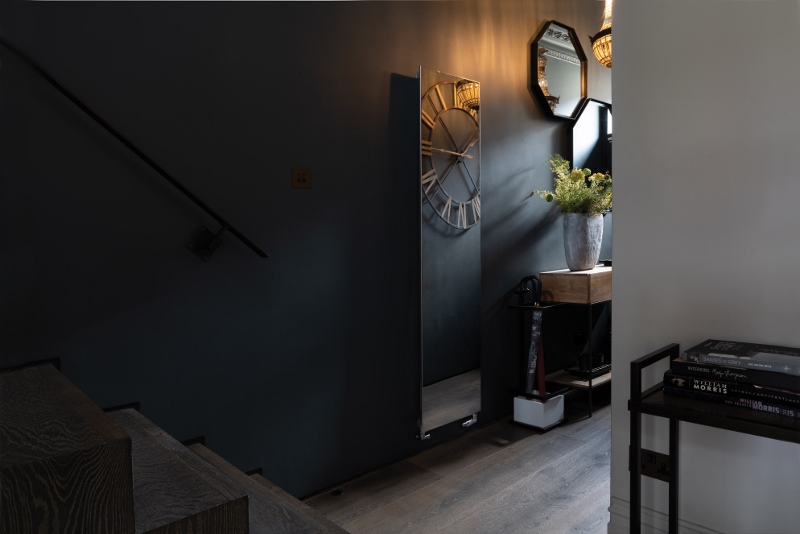 Dark hallway with mirror radiator
