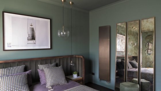 Bronze radiator in modern guestroom