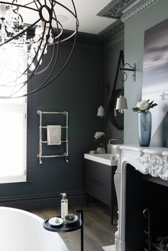 black and white room with traditional radiator