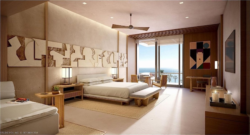 Raw materials, with hues of cream and browns, are featured in a modern guestroom with views of the ocean