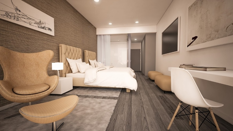 Modern guestroom with dark tones in the flooring and light, bright spots