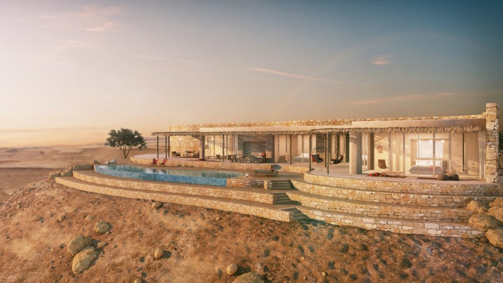 The modern low-level hotel perched on a cliff surrounded by nothing by desert