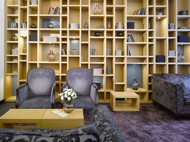 Living/lounge area with low seating and contemporary wooden bookshelf