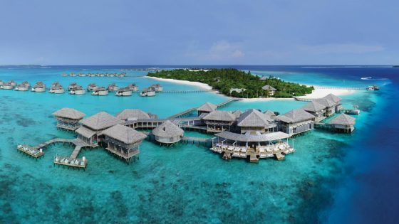 Aerial shot of a Six Senses hotel in the ocean
