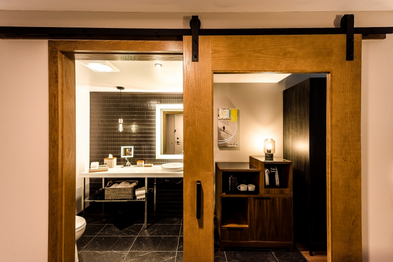 Image of modern bathroom with large sliding wooden doors