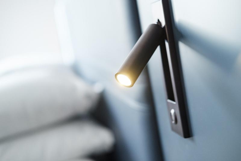 Reading lighting on side of headboard