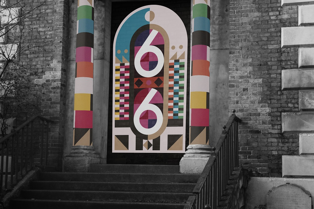 Image of colourful door on a church with the numbers 66 written