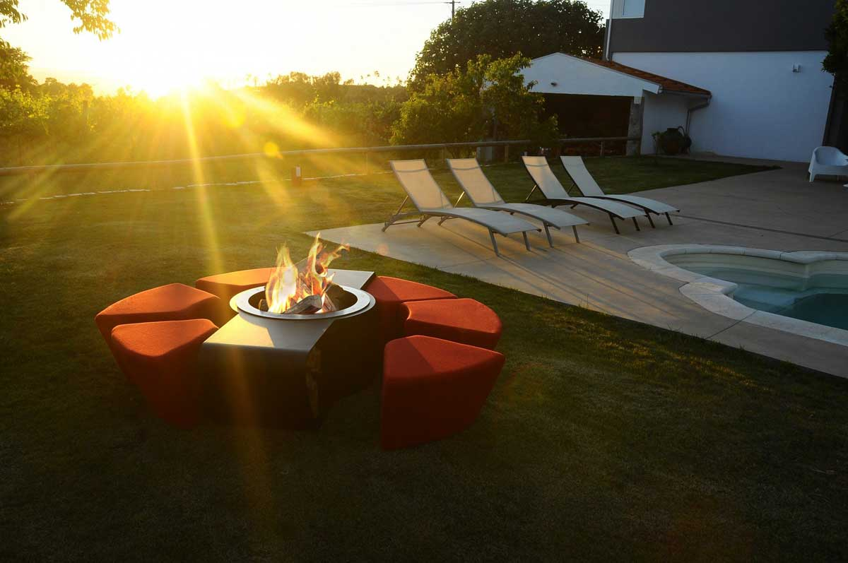 Red seating around low fire