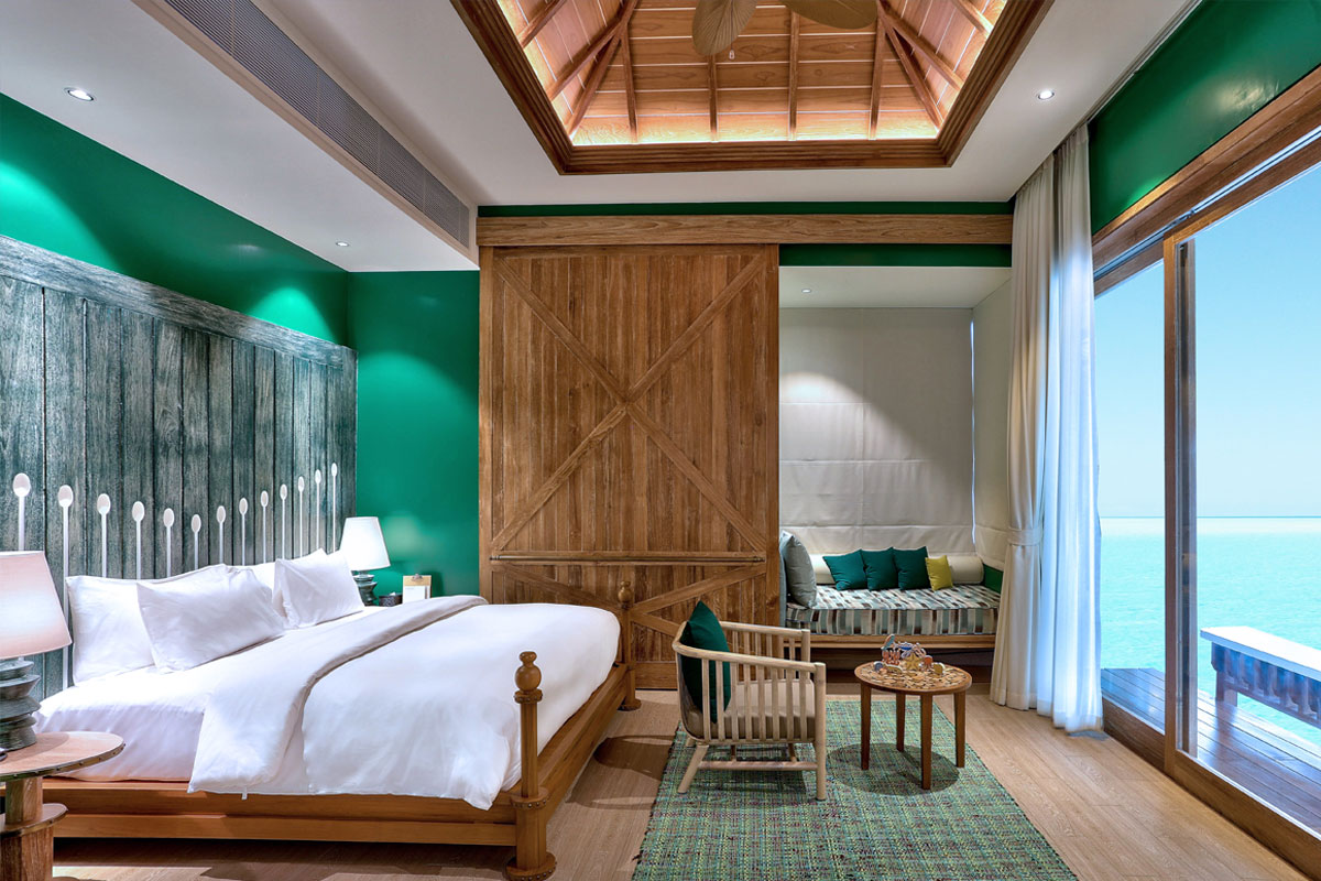 Render of green shack-like guestroom in the Maldives