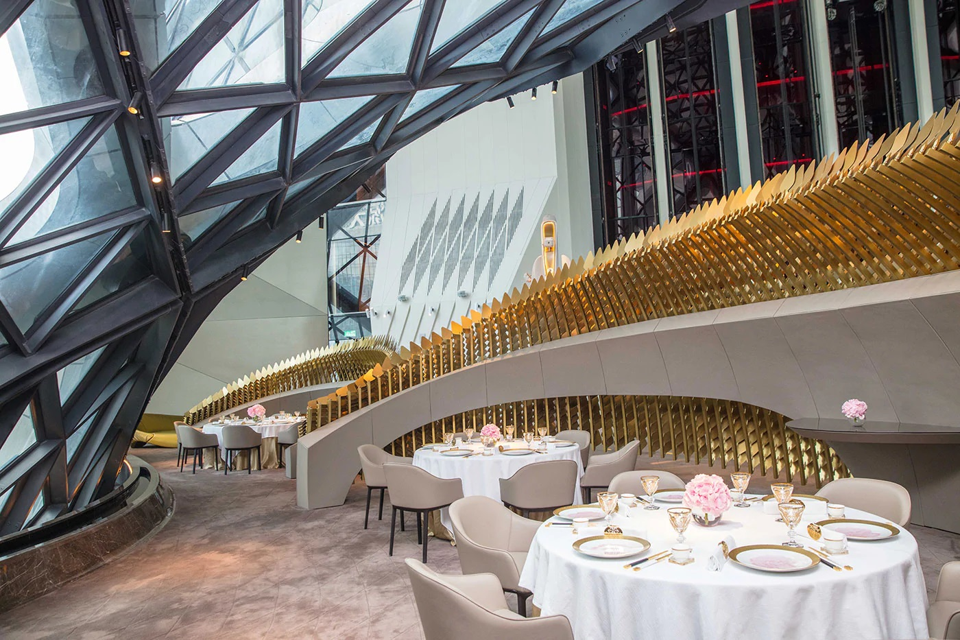 The sky bar, with sophisticated gold barriers between tables