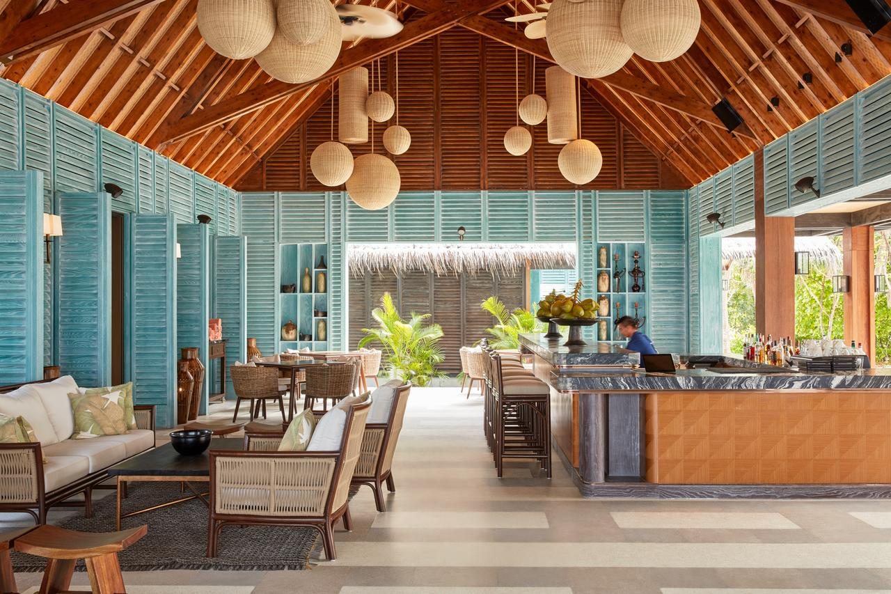 Beach blue wallcovering with wooden roof