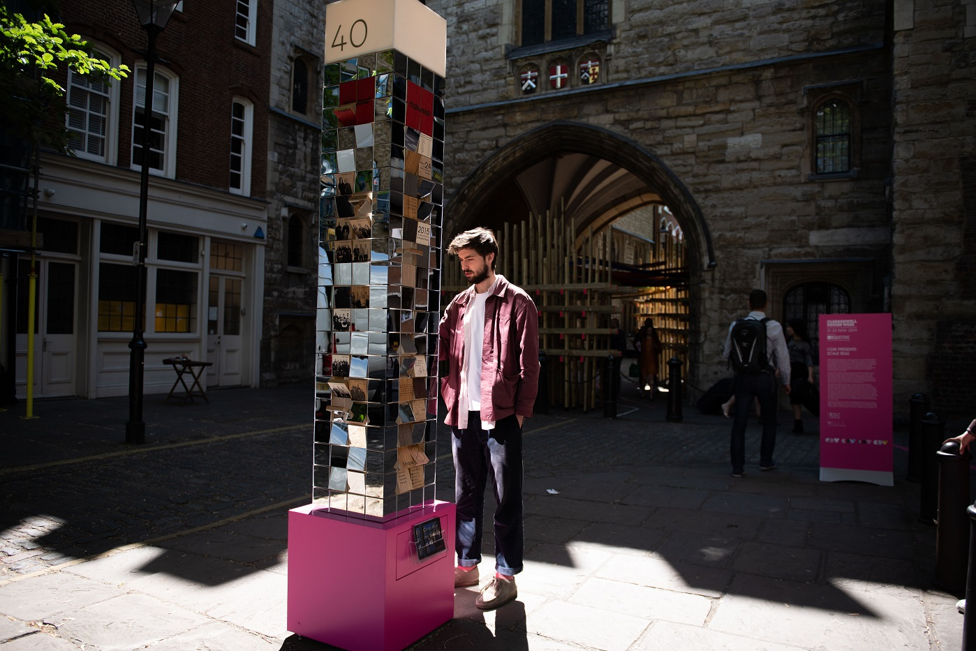 Man looking at the installation on the streets of Clerkenwell