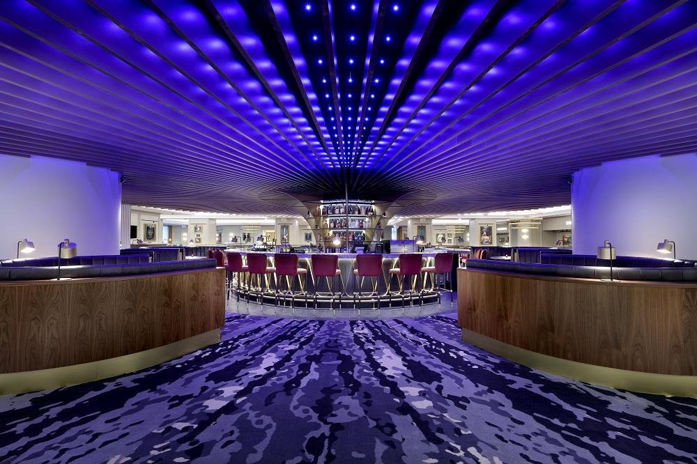 Purple lighting in large, swanky bar in London