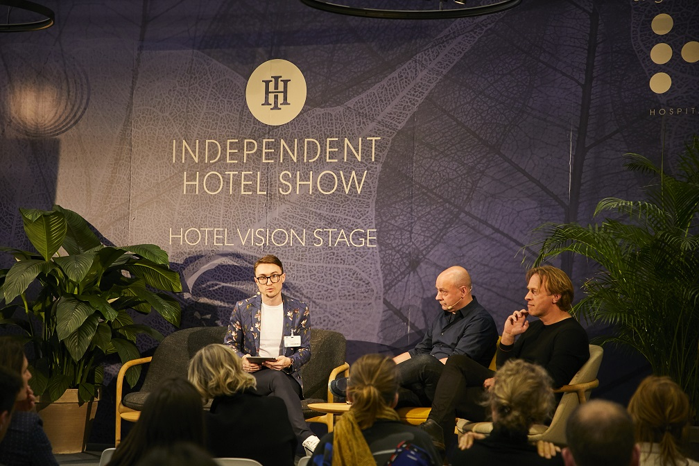 Three men on the Hotel Vision stage
