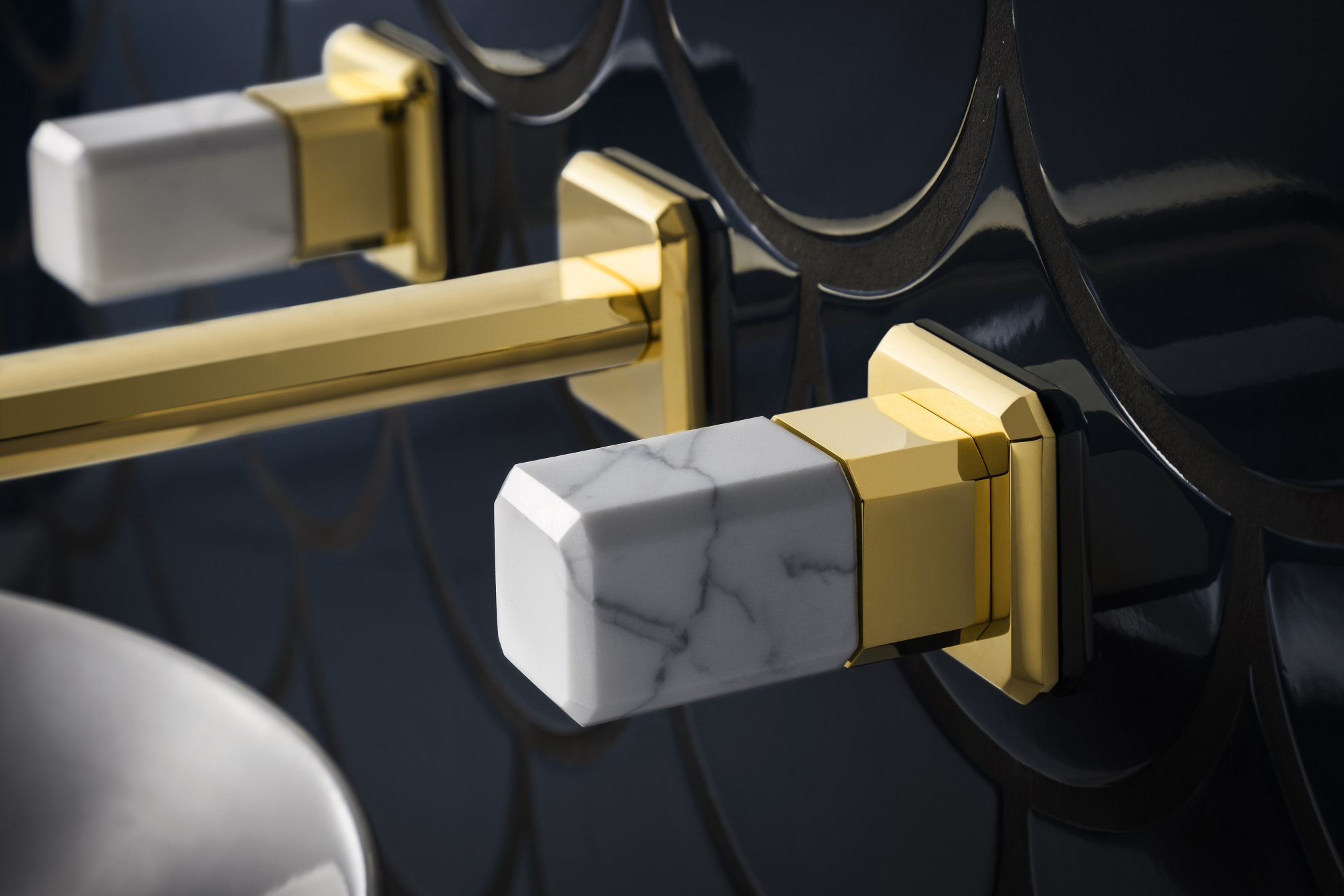 Close up of marble and gold fittings