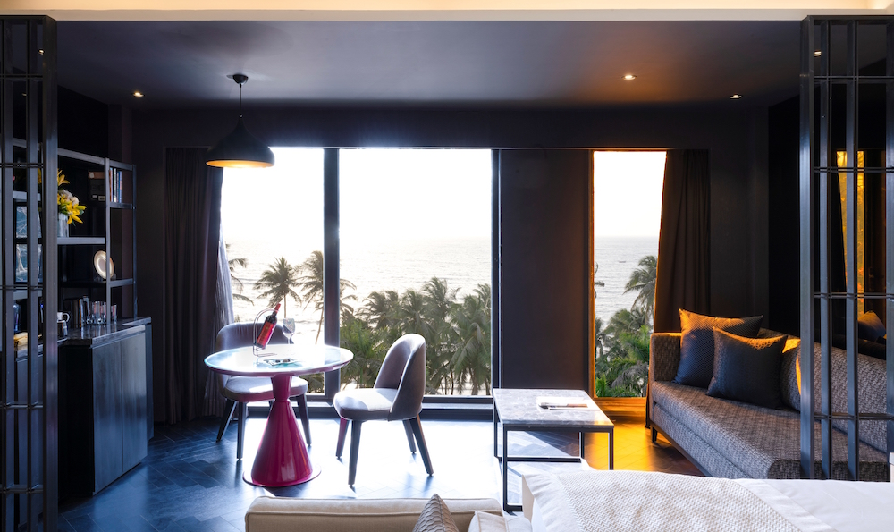 Contemporary hotel room, framing the sea and palm trees