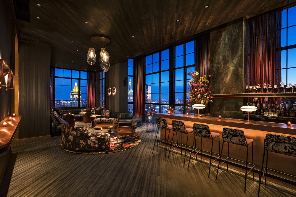 Dark-lit, open-planned room with lavish bar