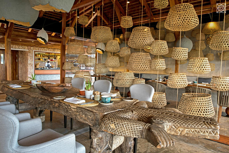 Sustainable materials - including furniture and lighting - make up the raw and rustic restaurant