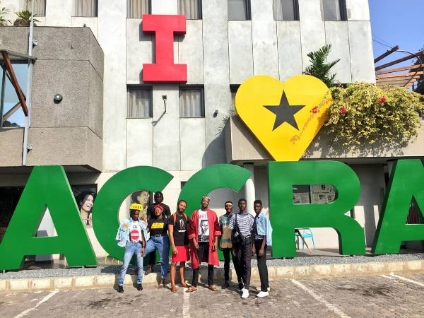 Team outside the sign 'I LOVE ACCRA' at hotel