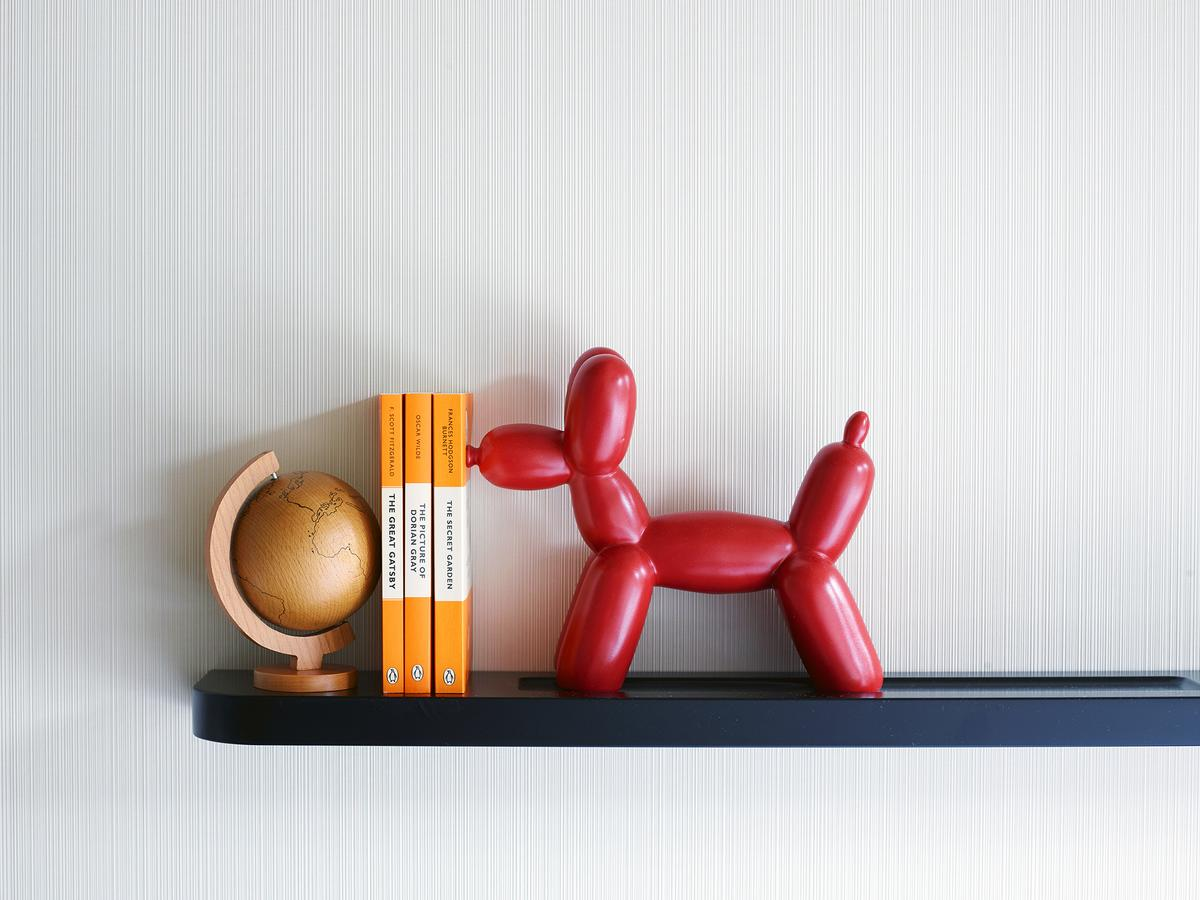 Dog accessory used as a bookstop