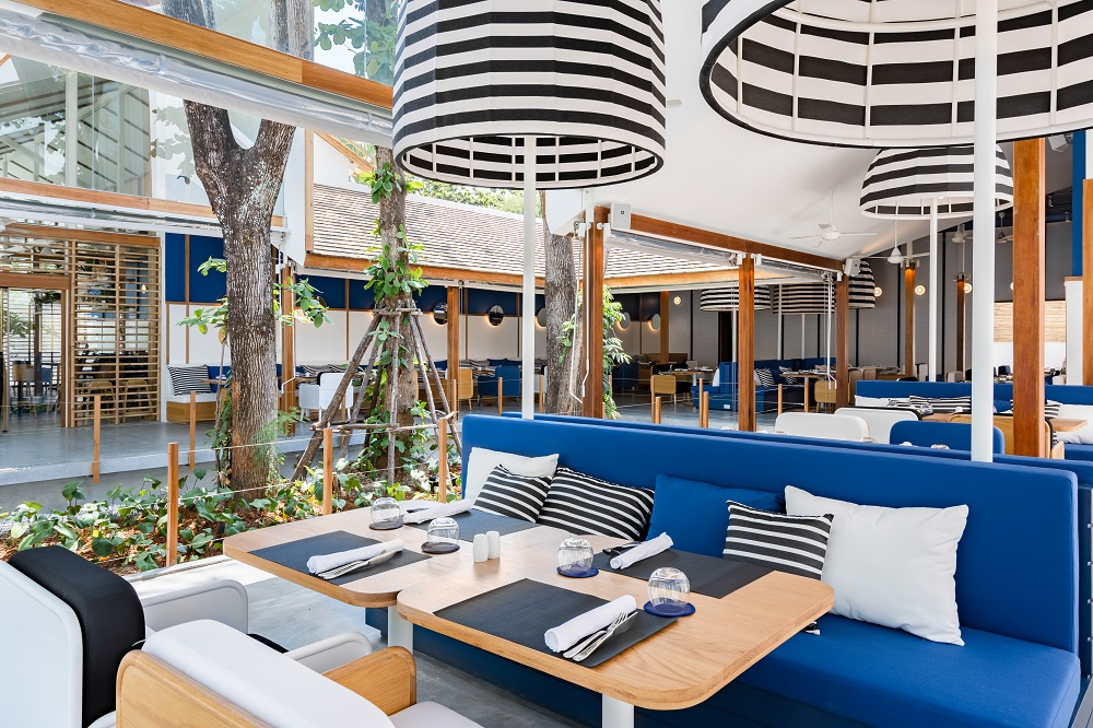 Blue and white decor in treehouse-like bar and restaurant