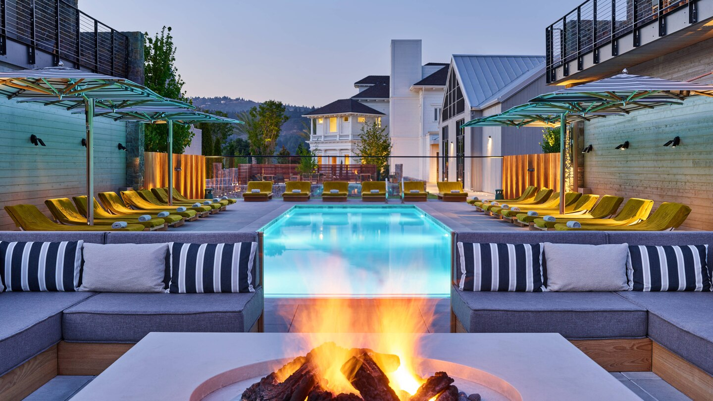 fire in front of luxury pool