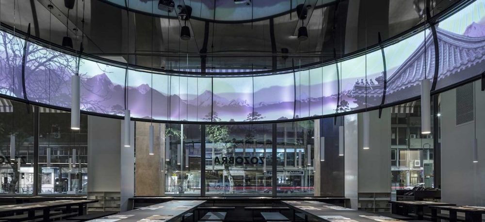 projector above tables and open front windows, the studio's design take on ying and yang