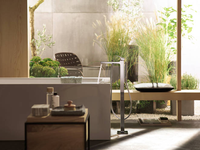 modern bathroom with running tap in botanical surroundings