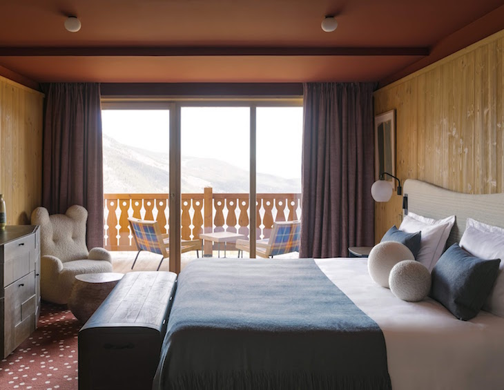 Chalet style guest room overlooking mountains