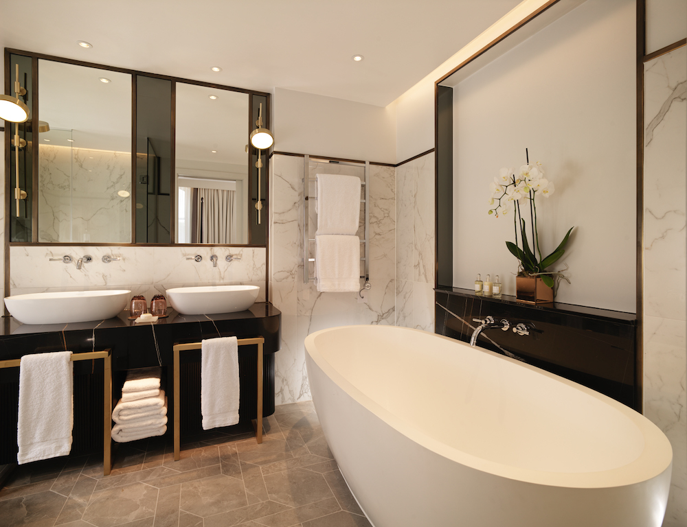Luxe bathroom with marble and large bath tub