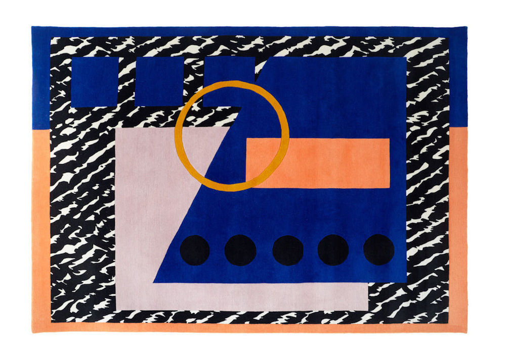 Bold designed rug with colours of blue, orange and black